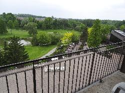 Room in Nottawasaga Inn Resort and Conference Centre, near Alliston Ontario.  View of golf course, conference patio and Nottawasaga River from balcony.
