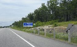 The welcome sign for Seguin Township, stating 'The Natural Place to Be'.  Located along highway 400 North, on the way to Parry Sound.